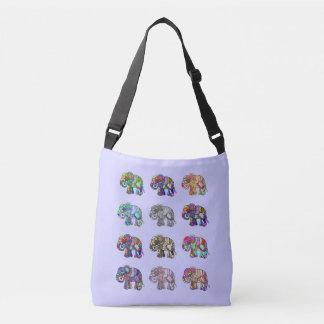 Variations of colorful ornamental elephants parade crossbody bag