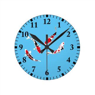 Varicolored carps round clock
