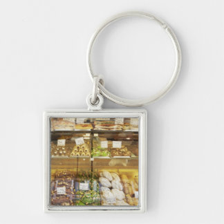 Variety of cookies in display case Silver-Colored square keychain