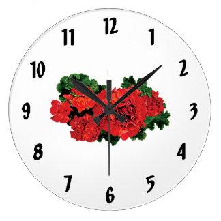 Varios geranios rojos reloj redondo grande