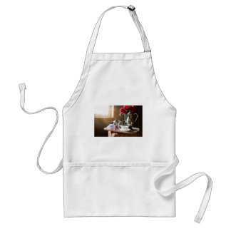 Various and useful objects with tea set adult apron