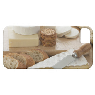 Various cheeses and bread on table iPhone 5 case