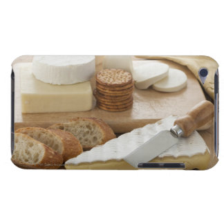 Various cheeses and bread on table iPod touch case