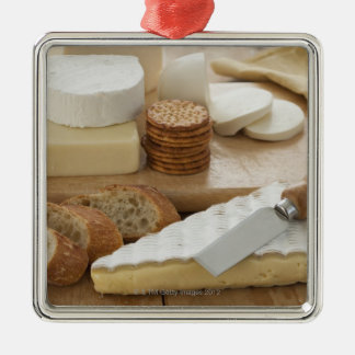 Various cheeses and bread on table metal ornament