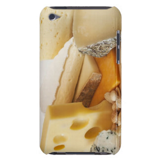 Various cheeses on chopping board iPod Case-Mate case