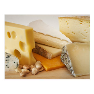 Various cheeses on chopping board postcard