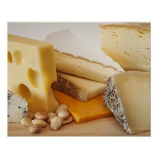 Various cheeses on chopping board poster