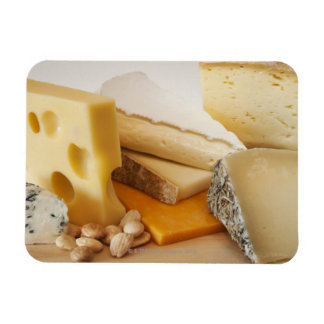 Various cheeses on chopping board rectangular photo magnet