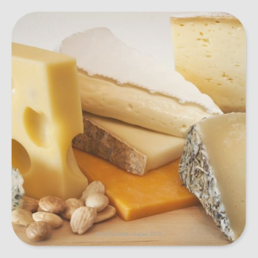 Various cheeses on chopping board square sticker