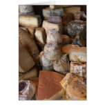 Various cheeses on market stall, full frame cards