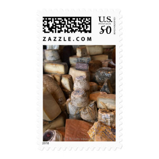 Various cheeses on market stall, full frame postage