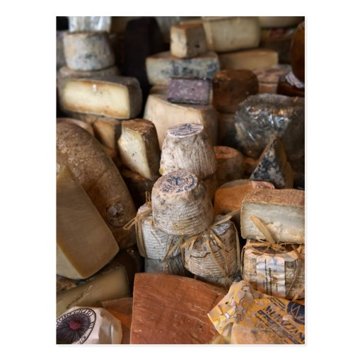 Various cheeses on market stall, full frame postcards