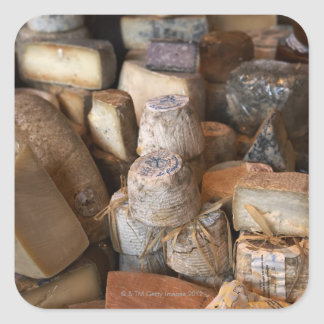 Various cheeses on market stall, full frame square sticker