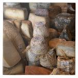 Various cheeses on market stall, full frame ceramic tile
