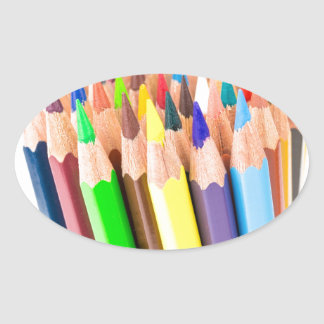 Various colered crayons standing upright oval sticker
