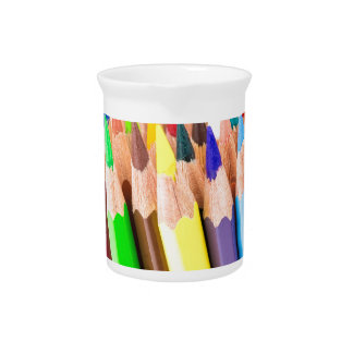 Various colered crayons standing upright pitcher