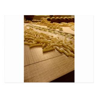 Various mix of fresh italian homemade pasta postcard
