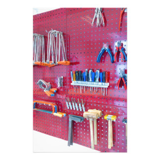 Various tools hanging at wall in high school stationery