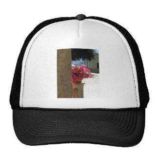 Vase of flowers just around the corner trucker hat