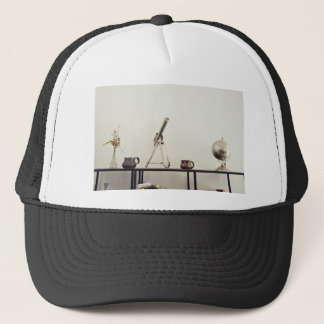 Vase Themed, The Picture Contains A Glass Vase Wit Trucker Hat