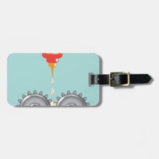 Vector de engrase de los engranajes etiqueta para maleta