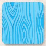 Vector de madera azul brillante del grano posavasos