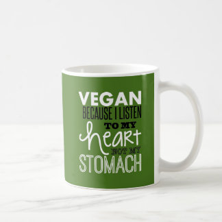 vegan because i listen to my heart not my stomach. classic white coffee mug
