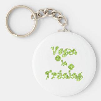 Vegano en el entrenamiento llavero redondo tipo pin