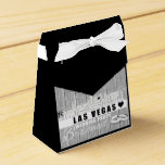 "Vegas Wedding Gift Ideas - Black Wood Favor Box<br><div class=""desc"">Wrap your wedding party gifts in elegance with these sophisticated black wood favor boxes. Your source for Las Vegas wedding gift ideas. If you are planning a unique Las Vegas wedding and looking for wedding favors to remember your special day then this Vegas Bride tote bag is perfect for the...</div>"