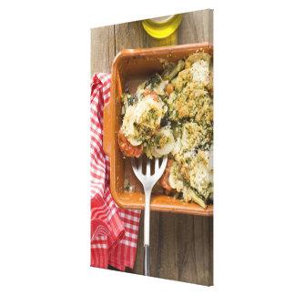 Vegetable bake with potatoes, tomatoes, leeks canvas print