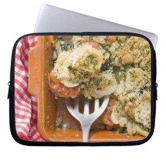 Vegetable bake with potatoes, tomatoes, leeks laptop sleeve