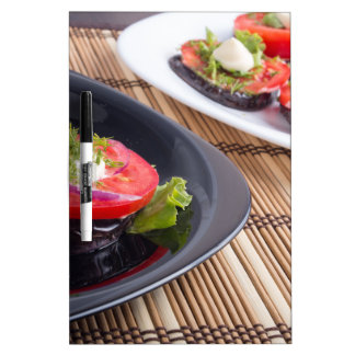 Vegetable dishes of stewed eggplant and fresh red Dry-Erase board