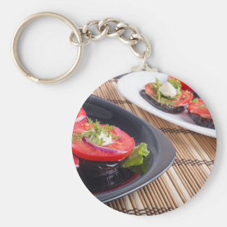 Vegetable dishes of stewed eggplant and fresh red keychain