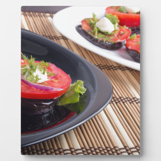Vegetable dishes of stewed eggplant and fresh red plaque