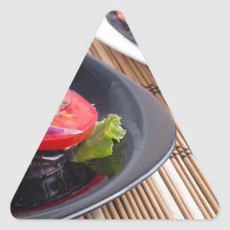 Vegetable dishes of stewed eggplant and fresh red triangle sticker