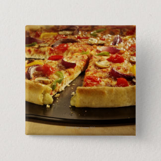 Vegetable pizza sliced on black pan on wood button
