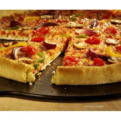 Vegetable pizza sliced on black pan on wood zazzle_mousepad