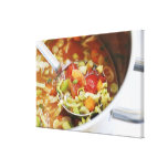 Vegetable soup in pan canvas print