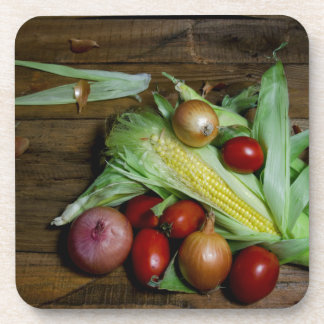 Vegetables on an old table. coaster