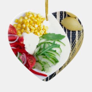 Vegetarian dish of raw vegetables and mozzarella ceramic ornament