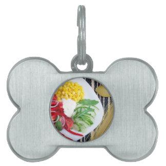 Vegetarian dish of raw vegetables and mozzarella pet ID tag