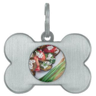 Vegetarian dish of stewed aubergine pet name tag