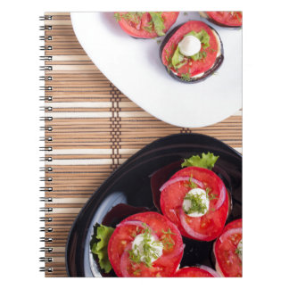Vegetarian dish of stewed eggplant and fresh tomat notebook
