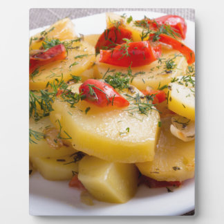 Vegetarian dish of stewed potatoes and bell pepper plaque
