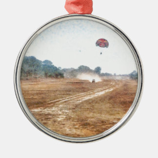 Vehicle and parasailing over land metal ornament