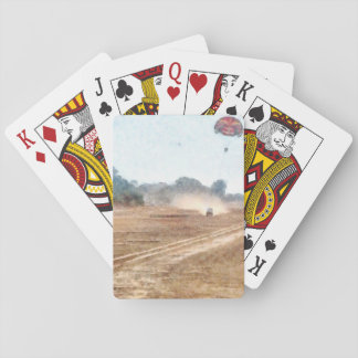 Vehicle and parasailing over land playing cards