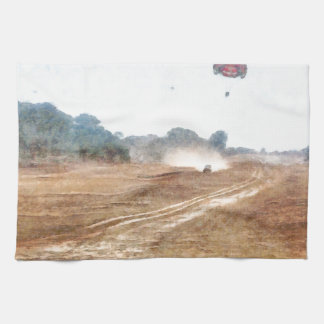 Vehicle and parasailing over land towels
