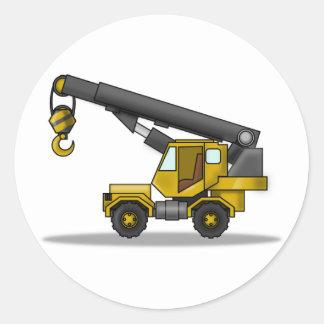 Vehículo amarillo y negro de la construcción de la pegatina redonda
