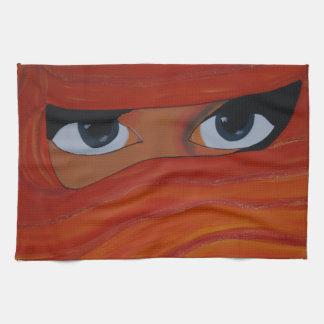 Veiled woman in orange hand towel