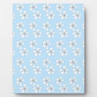 Vein flowers on blue plaque